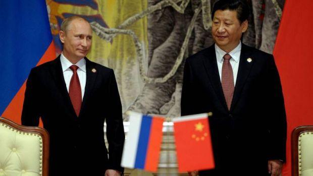 El presidente Ruso, Vladimir Putin, reunido con su homólogo chino Xi Jinping