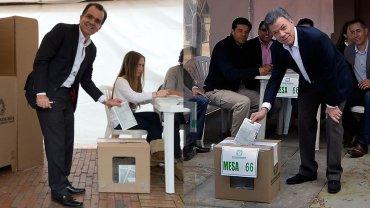 Zuluaga y Santos emiten su voto. Fueron parte del 40% que sí votó en los comicios del domingo.